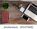 top view of wooden desk at a... | Shutterstock . vector #351475682