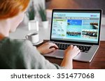 woman using laptop to book... | Shutterstock . vector #351477068