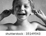 Boy Pulls Himself Over The Ears