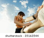 woman doing stretching outdoors ... | Shutterstock . vector #35163544
