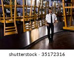 Worker Standing Next To Bar Of...