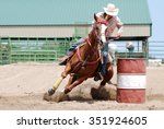 Cowgirl Racing Her Horse...