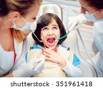 little girl and two dentists in ... | Shutterstock . vector #351961418