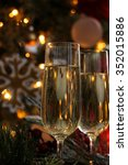 wine glasses against bokeh... | Shutterstock . vector #352015886