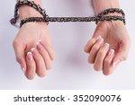 women's wrists in chains.... | Shutterstock . vector #352090076