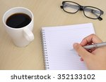 hand writing on notebook with... | Shutterstock . vector #352133102