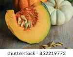 fresh pumpkin with seeds | Shutterstock . vector #352219772