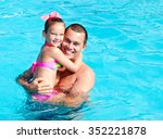 father and little girl having... | Shutterstock . vector #352221878