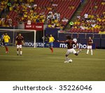 EAST RUTHERFORD, NJ - AUGUST 12: Oswaldo Vizcarrondo #6 of Venezuela kicks the ball during their International Friendly match at Giants Stadium on August 12, 2009 in East Rutherford, NJ - stock photo