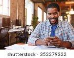 designer sitting at meeting...   Shutterstock . vector #352279322