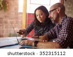 two designers with laptop... | Shutterstock . vector #352315112