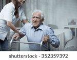 disabled man using a walking... | Shutterstock . vector #352359392