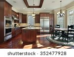 luxury kitchen with cherry wood ...   Shutterstock . vector #352477928