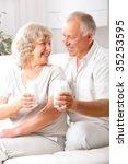 happy elderly couple drinking...   Shutterstock . vector #35253595