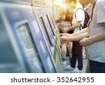 young man paying at ticket... | Shutterstock . vector #352642955