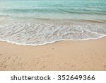 wave of the sea on the sand... | Shutterstock . vector #352649366