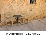 Table And Chairs Against A...