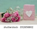 bouquet of roses and gift | Shutterstock . vector #352858802