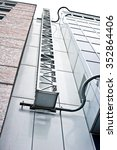 Small photo of An access ladder on the exteior of adjoining modern buildings in Germany