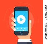 hand holding smartphone or... | Shutterstock .eps vector #352876355