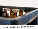 rows of empty glass bottles in... | Shutterstock . vector #352952576