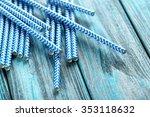 Striped Drink Straws On A Blue...