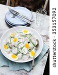 Small photo of Bowl of potato salad topped with hard boiled eggs and chives at a outdoor lunch meal, alfresco dining or at a barbecue