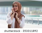 smiling girl in hijab covering... | Shutterstock . vector #353311892