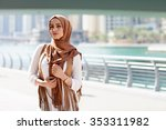 smiling girl in hijab covering... | Shutterstock . vector #353311982