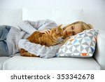 Stock photo young woman with red cat laying on sofa 353342678