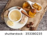 a white cup of green natural... | Shutterstock . vector #353380235
