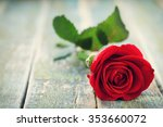 Stock photo red rose flower on vintage wooden background 353660072