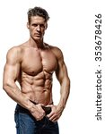 Small photo of Strong Athletic Man showing muscular body and sixpack abs over white background