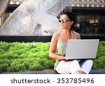 woman with laptop outdoor | Shutterstock . vector #353785496