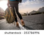 female hitchhiker walking with... | Shutterstock . vector #353786996