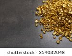 A Pile Of Gold Nugget Grains ...