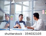two employees discussing data... | Shutterstock . vector #354032105