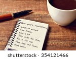 a cup of coffee and a notebook... | Shutterstock . vector #354121466