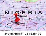 Small photo of Abuja pinned on a map of Africa