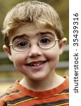 portrait of boy with eyeglasses | Shutterstock . vector #35439316