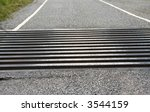 Close Up Of Cattle Grid On Roa...
