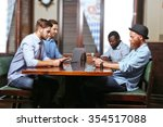young men talking in cafe | Shutterstock . vector #354517088