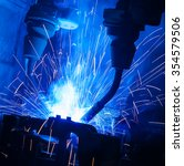welding robots movement in a... | Shutterstock . vector #354579506