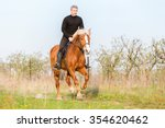 Man Riding Gallop Horse In...