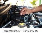 car's mechanic checking oil. | Shutterstock . vector #354754745