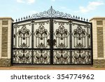 iron gate with wrought ornament ... | Shutterstock . vector #354774962