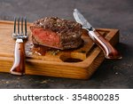 Filet mignon steak on wooden...