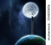 Businessman Standing On Ladder...