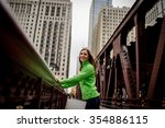 young smiling woman standing on ... | Shutterstock . vector #354886115