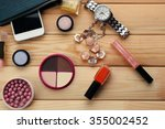 make up bag with cosmetics on... | Shutterstock . vector #355002452